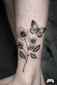 black and grey with flowers and butterfly by cobra