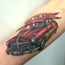 car enthusiast tattoo eat the road old muscle car tattoo on arm