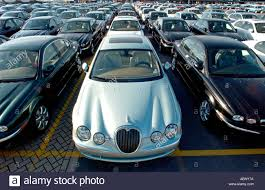 jaguar cars long lines of brand new jaguar cars await export at wallenius