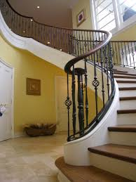 Free Standing Stairs Design The Wooden Stair Treads Wrought Iron Spindles And Warm Paint