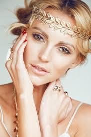 greek dess hair woman wearing a gold leaf crown the makeup