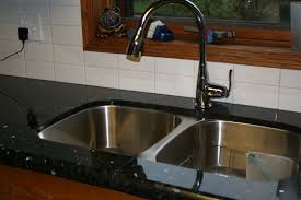 backsplash seal around kitchen sink leaky sink basket strainer