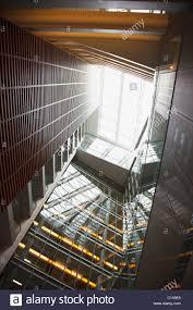 atrium sliding glass doors glass atrium and skylight in modern office building stock photo