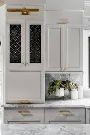 light gray kitchen cabinets light gray kitchen cabinets with brass grille doors