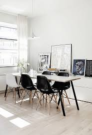 black and white interior style dining room with a mix of white