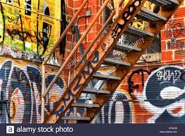 wall painting steel stairs orange corner building stairs steps on