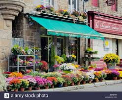 flower shops in a flower shop in a pretty building in the market place of