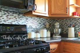 interior stunning cobblestone backsplash with wooden cabinet