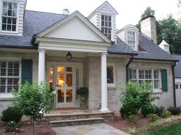 classic colonial cottage whitewashed brick teal shutters door