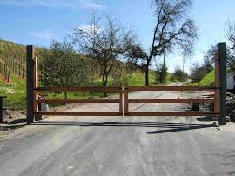 stunning straight up wooden sliding driveway gates with iron