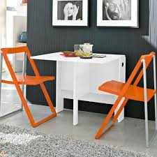Modern L Shaped Kitchen With Island Dining Room White Space Saving Table And Orange Folding Chairs
