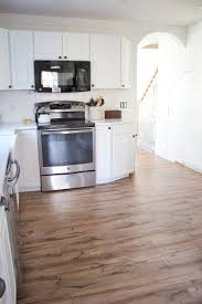 Hickory Laminate Flooring Kitchen Progress Pergo Flooring Before And After Lauren Mcbride