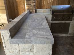 outdoor kitchen countertop ideas houston outdoor kitchen with silver travertine tile countertop