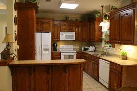 small kitchen layout wood kitchen cabinet and wood table also