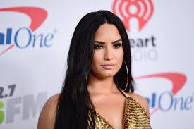 demi lovato earrings demi lovato sports daring cleavage in tiny top