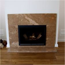 black iron fireplace frame with brown marble surround and white