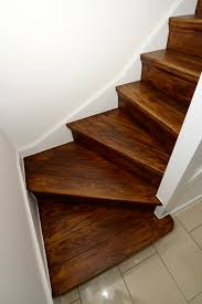 small dark wood staircase design with white wall color idea