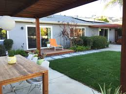 mid century modern backyard outdoor concrete pavers pads pergola