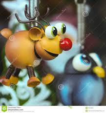 a rudolph the nosed reindeer ornament with a penguin stock