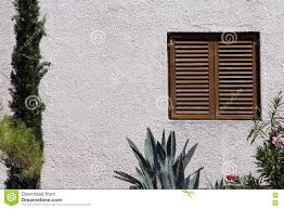 window with wooden blinds on white wall stock photo image 71582989