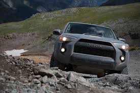 toyota hunting truck off roading to the summit in a tacoma tundra and 4runner