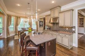 traditional kitchen with crown molding u0026 pendant light in marietta