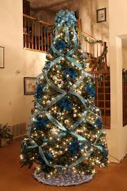 blue and silver elegant christmas tree with a little disney