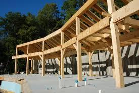 niemela design timber frame house built into the hill jaffrey
