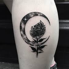 beautiful rose flower and crescent moon tattoo on back leg