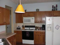 yellow kitchen decorating ideas small kitchen decoration using white laminate cream counter tops
