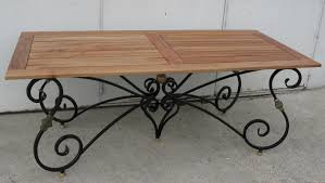 wrought iron dining room table 1 dining table with base in black wrought iron and gilded with teak