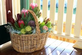 native flower arrangement in a basket a how to tutorial by