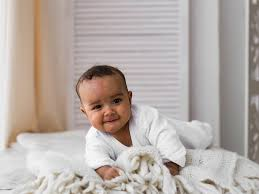 Baby Sleeping In A Crib by When Can My Baby Sleep With A Blanket Babycenter