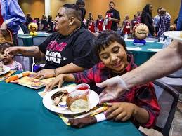 salvation army serves thanksgiving dinner to thousands in