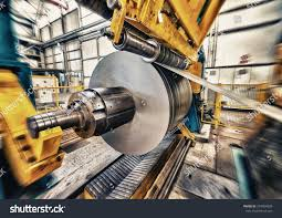 metal coils machine interior factory business stock photo