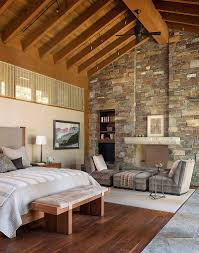 25 bedrooms that celebrate the textural brilliance of stone walls