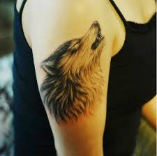 howling wolf tattoo on shoulder
