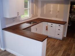 walnut edge grain butcher block wood countertop in white kitchen