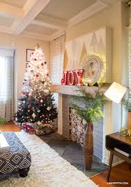 holiday living room reveal lia griffith modern chair christmas christmas entryway berry balls christmas mantel christmas reflection mirror christmas tree fireplace entryway details
