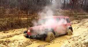 muddy jeep cherokee how to destroy a brand new jeep wrangler in the mud autoevolution
