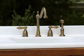 kingston kitchen faucets antique brass wall mount kitchen faucet cross handle adj center