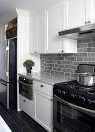 backsplash for black and white kitchen 35 ways to use subway tiles in the kitchen digsdigs