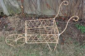 wrought iron wheelbarrow garden cart decorative container for flowers