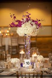 wedding flowers london ontario aqua blue centerpiece with flowers and crystals by luxe