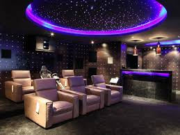 exclusive home theatre design that provide private entertaining astounding design of the home theater ideas with purple ceiling lamp ideas and small bar beside