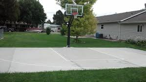 pro dunk gold basketball system is built in the backyard of the