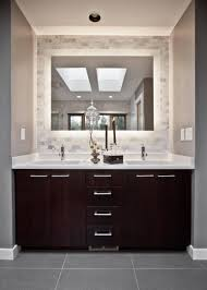 stone accent wall arched rectangle mirror with dark brown frame