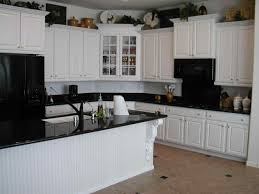 l shaped kitchen using white beadboard cabinet doors and apron