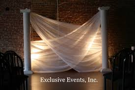 wedding backdrop ideas with columns ceremony backdrops unconventional swag with fabric and columns