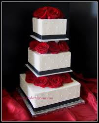 black and white square wedding cake with red roses wedding cakes